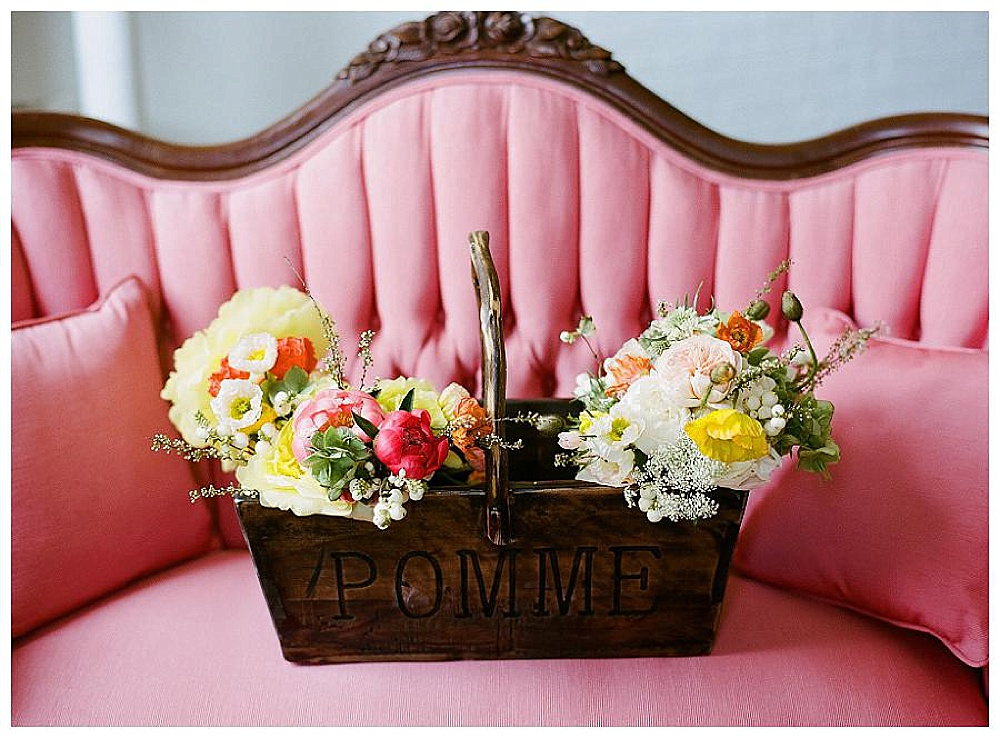Flowers on chairs. Paisley and Jade specializing in vintage and eclectic rentals for weddings trade shows photo shots or film and theatrical productions