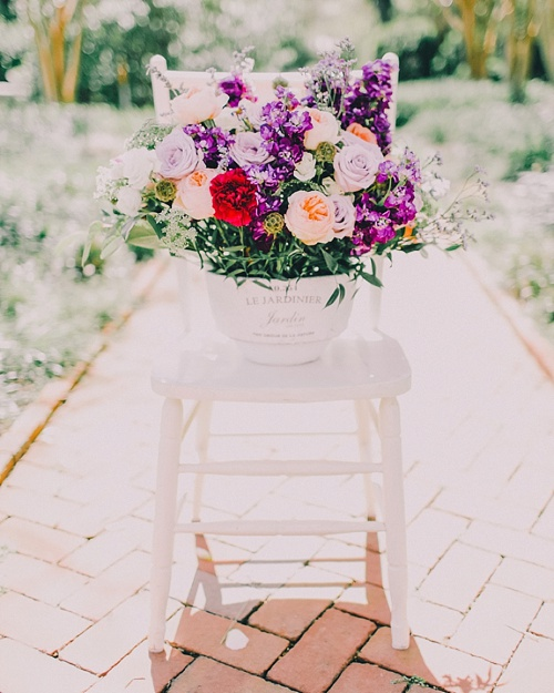Gorgeous wedding and event floral designs and bouquets displayed on chairs. Paisley and Jade specializing in vintage and eclectic rentals for weddings trade shows photo shots or film and theatrical productions