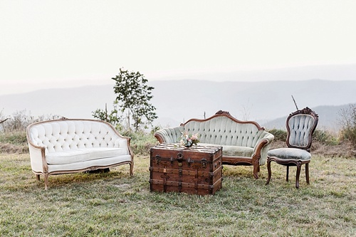 Classic vintage lounge at Caroline & Ty's real wedding with vintage furniture rentals by Paisley & Jade