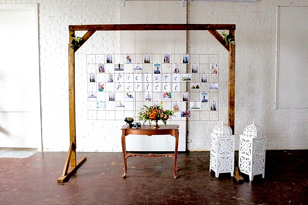 Modern metallic photo display and seating chart by Paisley and Jade