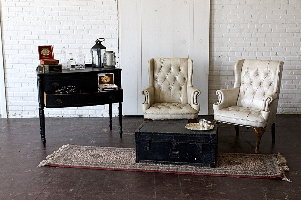 Simple and sophisticated cigar bar and whiskey lounge created with rental items by Paisley and Jade