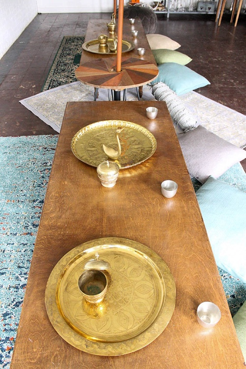 Inspiration station with gorgeous boho-chic low set wooden tables built and styled by Paisley and Jade