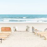 Gorgeous oceanfront beach wedding in Sandbridge Virginia with eclectic and vintage furniture and decor rentals by Paisley and Jade