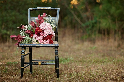 Beautiful winter inspired flowers on chairs moments with specialty and vintage rentals by Paisley & Jade