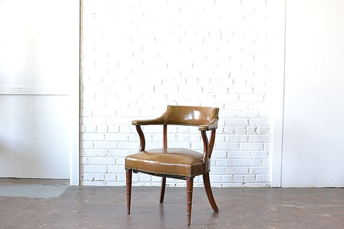 The Adams leather chair available for rental by Paisley & Jade