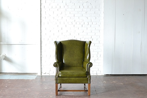 The Franklin upholstered chair available for rent by Paisley & Jade