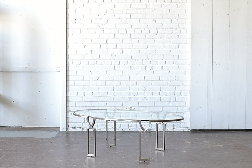 Gold and Glass Oval Coffee Table available for rent by Paisley & Jade