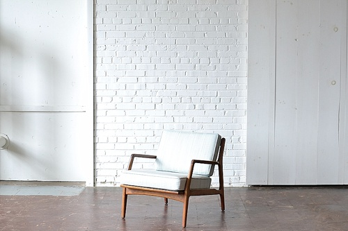 Mid Century Modern chair available for rent by Paisley & Jade