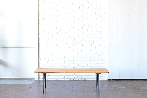 Mid Century Modern coffee table available for rent by Paisley & Jade