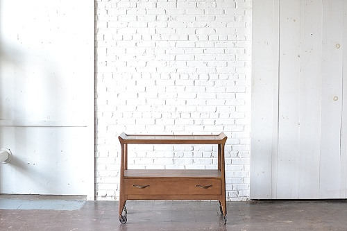 Mid Century Modern bar cart available for rent by Paisley & Jade