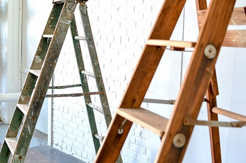 Arbor created with vintage ladders and copper decor pieces available for rent by Paisley and Jade