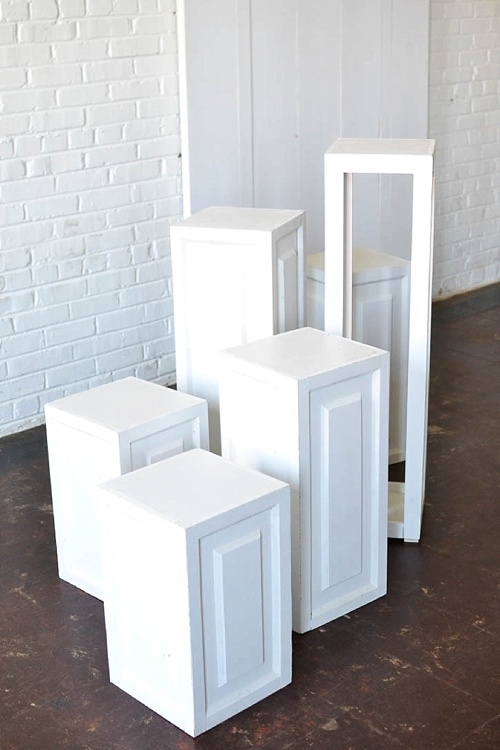 Inspiration Station wedding ceremony design featuring wooden pedestals and chairs available for rent by Paisley and Jade