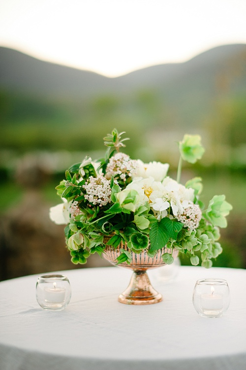 Styled shoot featuring copper urns and other specialty decor items available for rent by Paisley & Jade