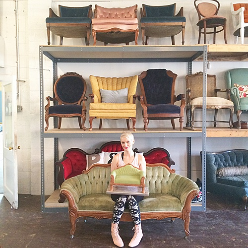 Amanda from Sweet Fix poses on the Thurmont, a victorian style settee upholstered in soft sage green velvet with pretty carved wood details. This settee is perfect for lounge areas, sweetheart seating, photo shoots, or cakes!