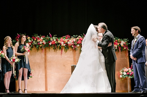 Elegant Copper Wedding Ceremony at Altria Theater in Richmond, Va with specialty rentals by Paisley & Jade