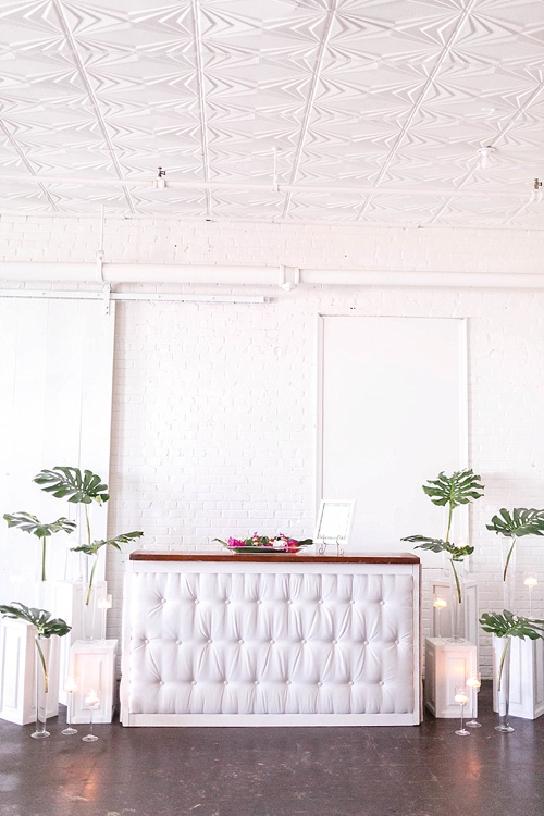 Tropical and white wedding styled shoot and photography workshop with showroom and specialty rentals by Paisley & Jade