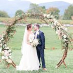 Romantic summer outdoor winery wedding with wooden arbor available for rent by Paisley and Jade