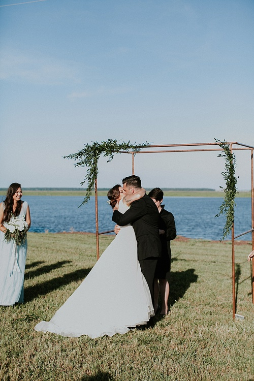 Cool and modern riverside wedding in Virginia with vintage and specialty rentals by Paisley and Jade