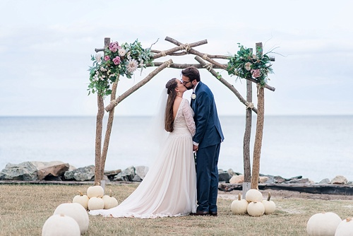 Wonderful waterfront Fall wedding on the Eastern Shore of Virginia with specialty and vintage rentals provided by Paisley and Jade