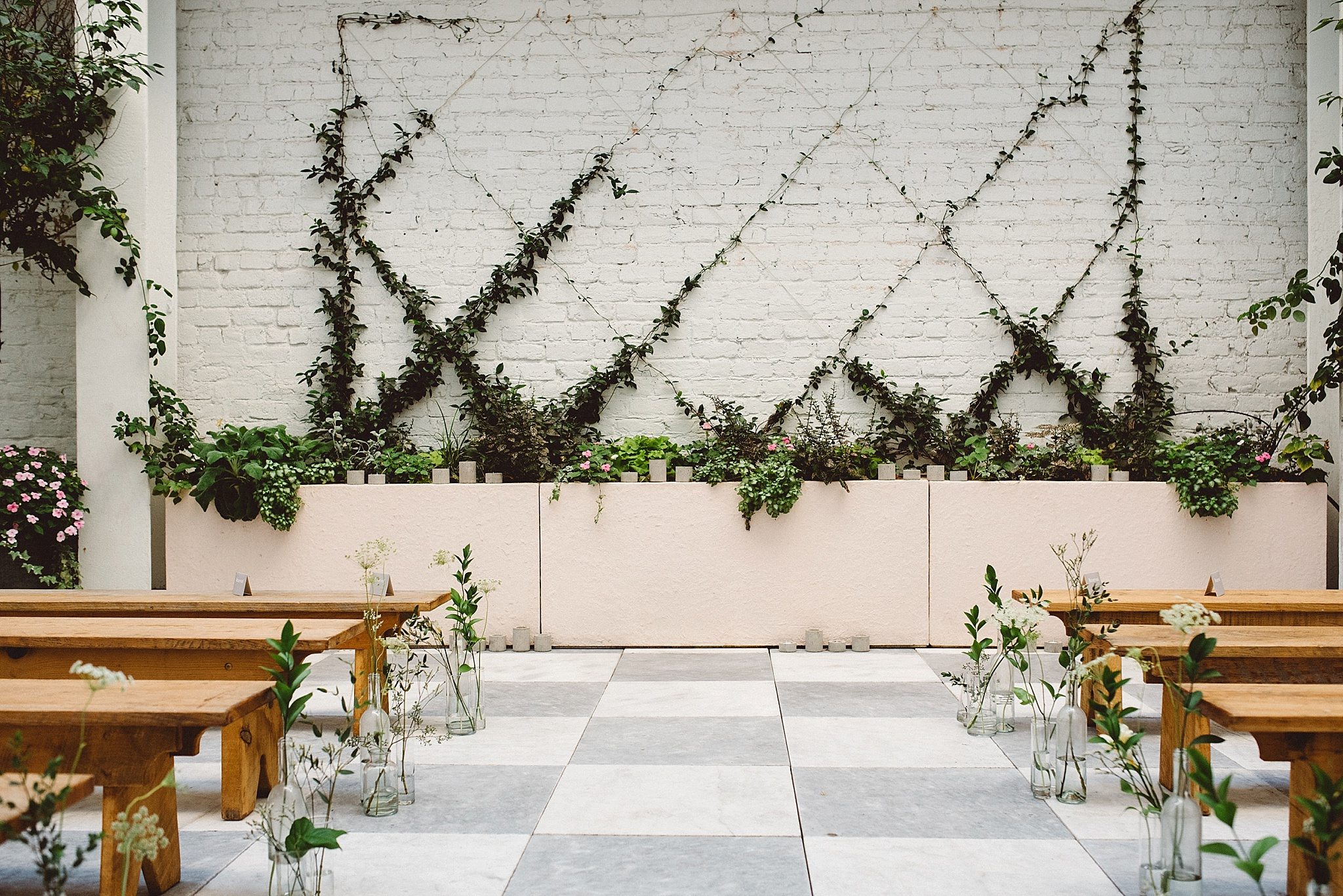 Chic and charming courtyard wedding at Quirk Hotel in Richmond, Virginia with specialty and vintage rentals by Paisley & Jade