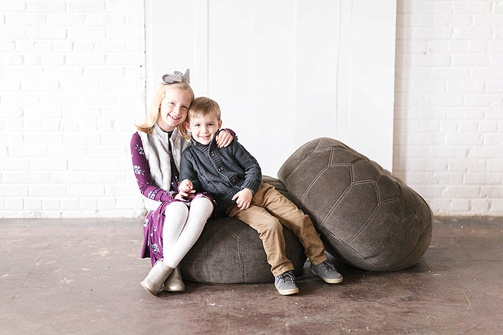 Cute and charming family holiday photos with studio space and specialty rentals provided by Paisley & Jade