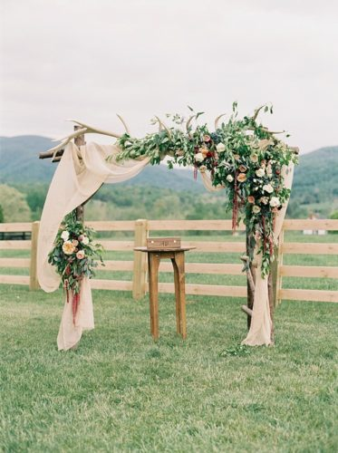 Beautiful boho farm wedding and reception with specialty and vintage rentals by Paisley & Jade