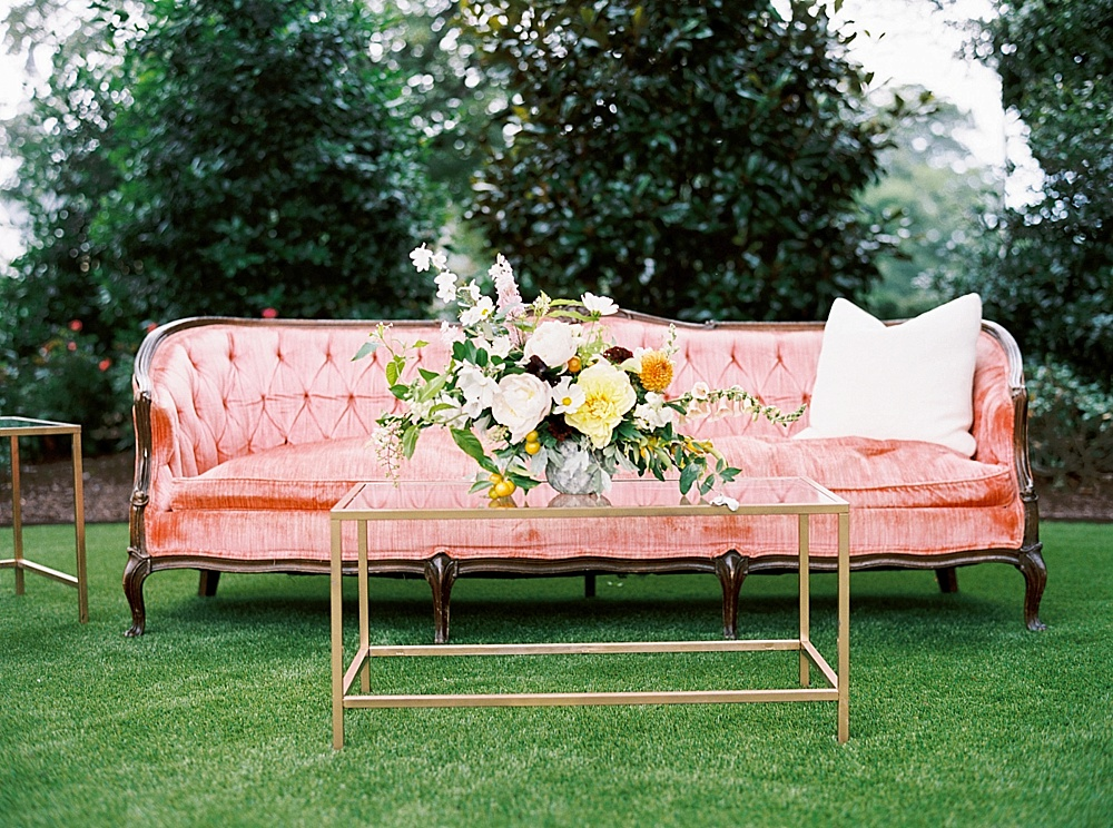 Beautiful pink vintage sofa stuns in various events with rental by Paisley and Jade