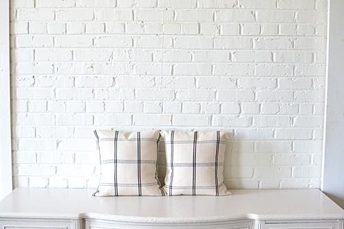 pair of neutral plaid pillows